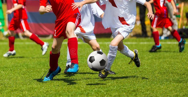 Football Soccer Kick. Soccer Players Duel. Children