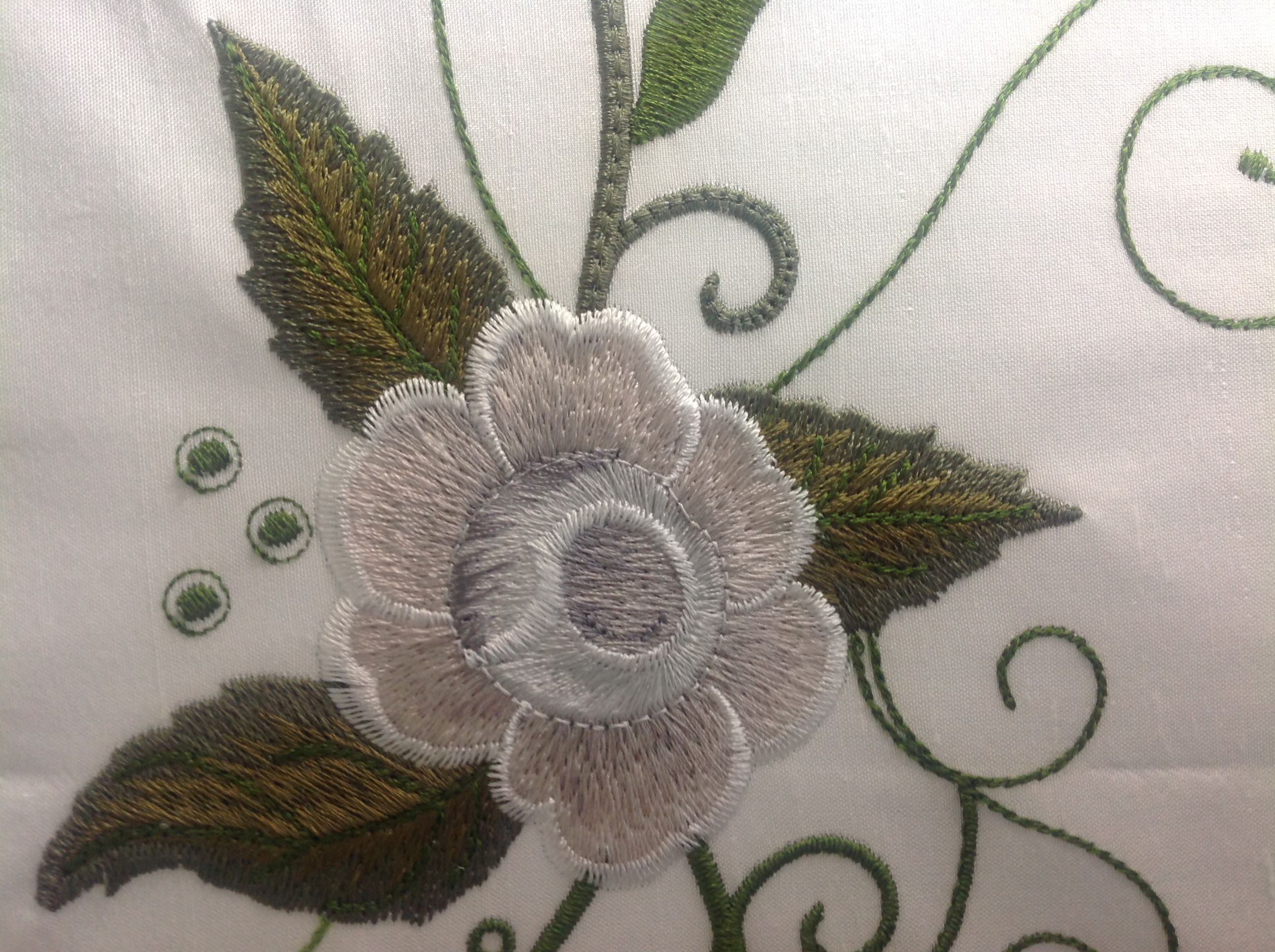 Try the Embroiderer's Prayer roses in shade of grey and white.