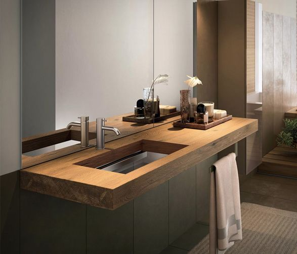The Depth Basin by Italian brand Lago is the perfect blend of a thick wooden shelf and a transparent glass washbasin. The single washbasin brings an authentic piece of nature into the bathroom, the 8cm thick rustic Wildwood shelf has a central part t