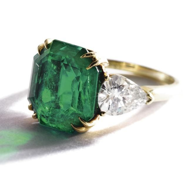 The emerald weighing 6.88 carats, flanked by pear-shaped diamonds weighing 1.50…