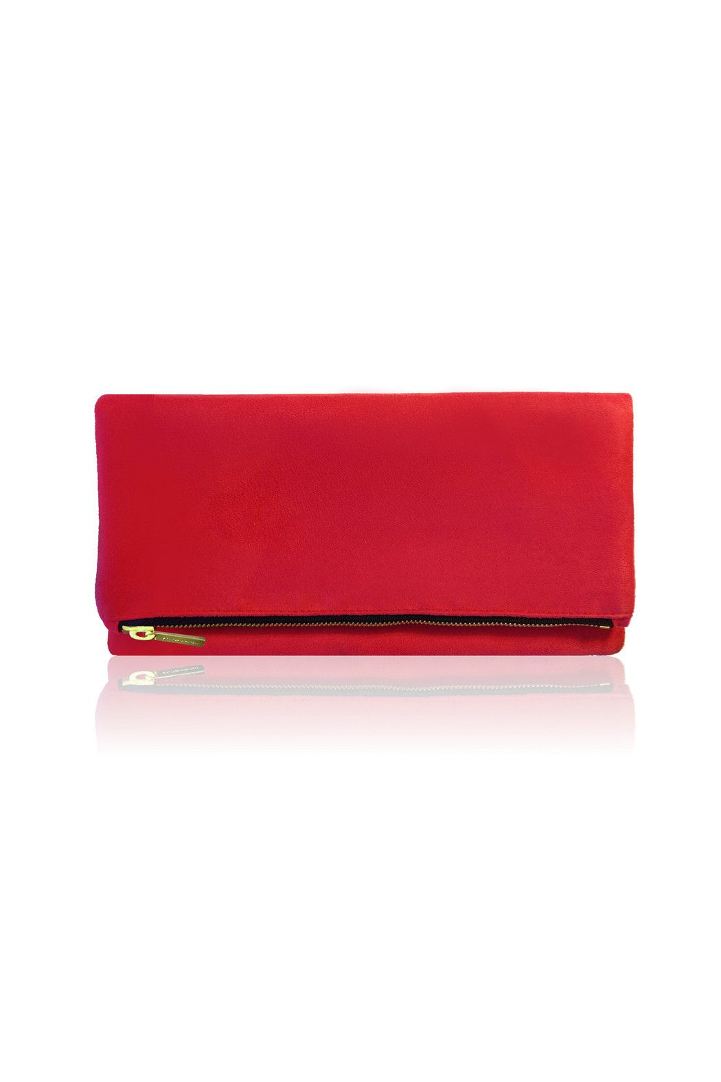 """This foldover clutch is the result of notable 21st century craftsmanship. The smooth, carefully selected materials, distinctive polka dot lining and the fine stitching along with the seams cause this foldover clutch to elegantly stand out. This is luxery redefined. Style it with skinny jeans and a blouse or a cocktail dress and your favorite pumps!    Colors may appear different on screen.    Dimensions: 11""""L x 6""""H x 1""""W    Open: 11x11""""    Featured on: A Little Dash of Darling…"""