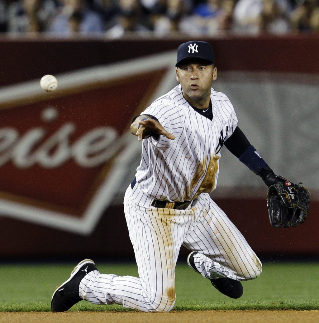 New York Yankees Shortstop Derek Jeter Throws To Second Baseman Robinson Cano Yankees Yankees Baseball Baseball
