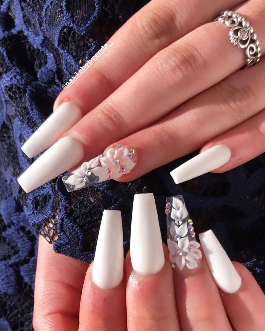 Cute white coffin nails design with accent floral nail ...