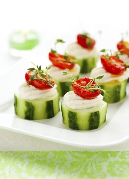 Cucumber cups with cream cheese and sundried tomatoes topped with fresh herbs make a colourful holiday veggie appetizer. (Svetlana Kolpakova...