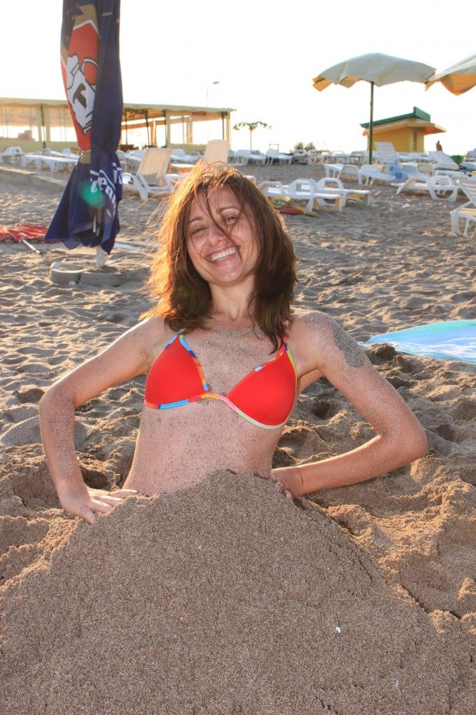 Woman Buried In Sand On Beach Public Domain Photos Free Images For Commercial Use