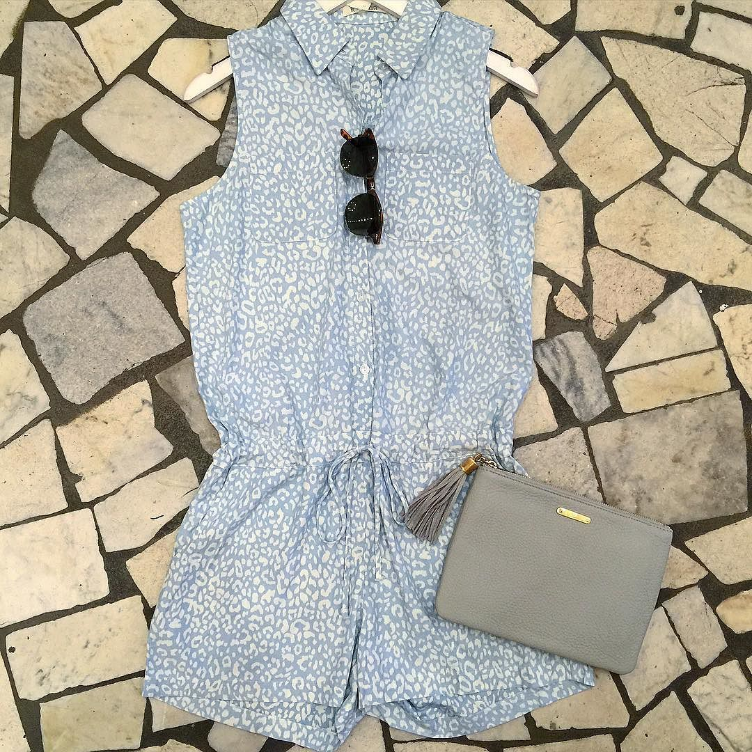 Sweet print chambray romper just in for Spring! $89 available at both Cella's locations! Call us to order or ship- (504) 592-7510 or (504) 529-5110 / Paired with @giginewyork pebble leather clutch available at Cella's French Quarter #springstyle #romper #print #leather #giginewyork #cellasboutique #magazinestreet #frenchquarter by shopcellasboutique