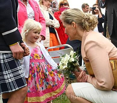 The Countess of Wessex receives a posy during her visit to the Lincolnshire Show, 20 June 2013