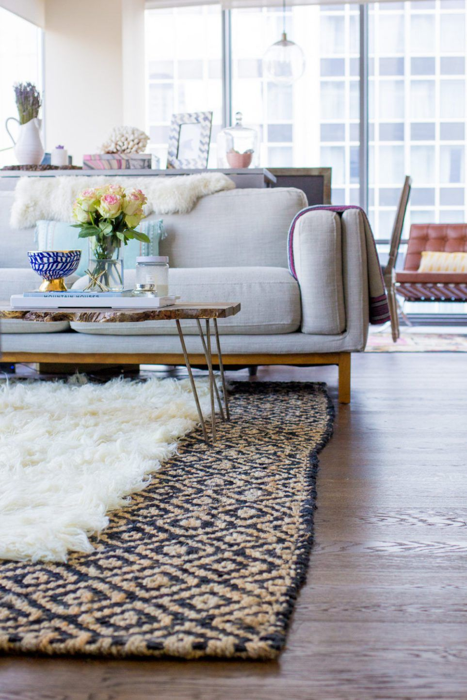 How To Layer Rugs Like A Designer Rugs In Living Room Living