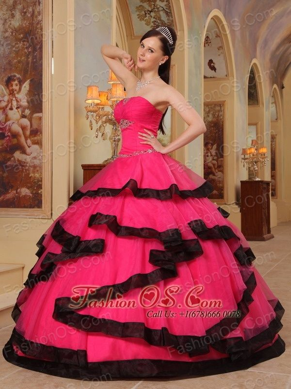 Gorgeous Coral Red and Black Quinceanera Dress Strapless Organza Appliques Ball Gown http://www.fashionos.com Strapless dresses are one of the sexier styles on the market today. They show just enough skin to be classy without being too revealing.This quinceanera dress features shimmering beads on the bodice and spreads around the waist, while the black trimed layers of pieced fabric add another dimension of beauty to an already lovely gown.