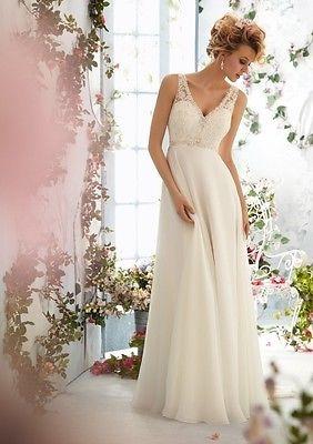 New white/ivory wedding dress. Beaded Empire.