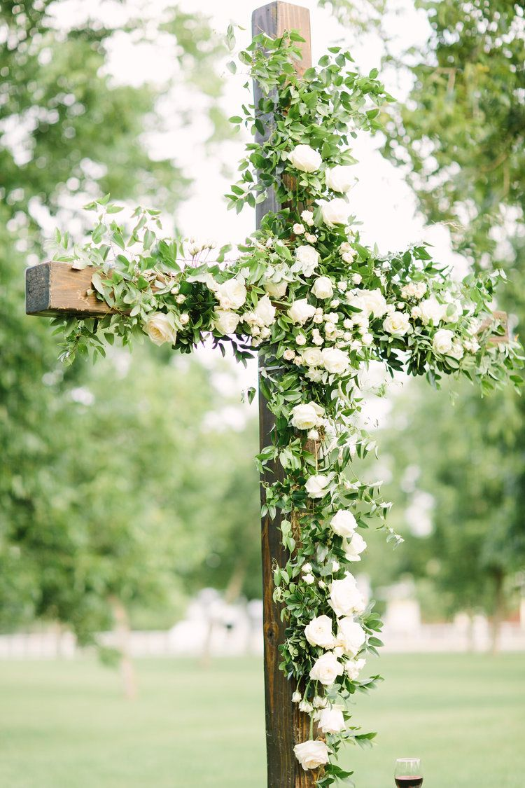 Flower Installation On A Wooden Cross With Greenery And Garden