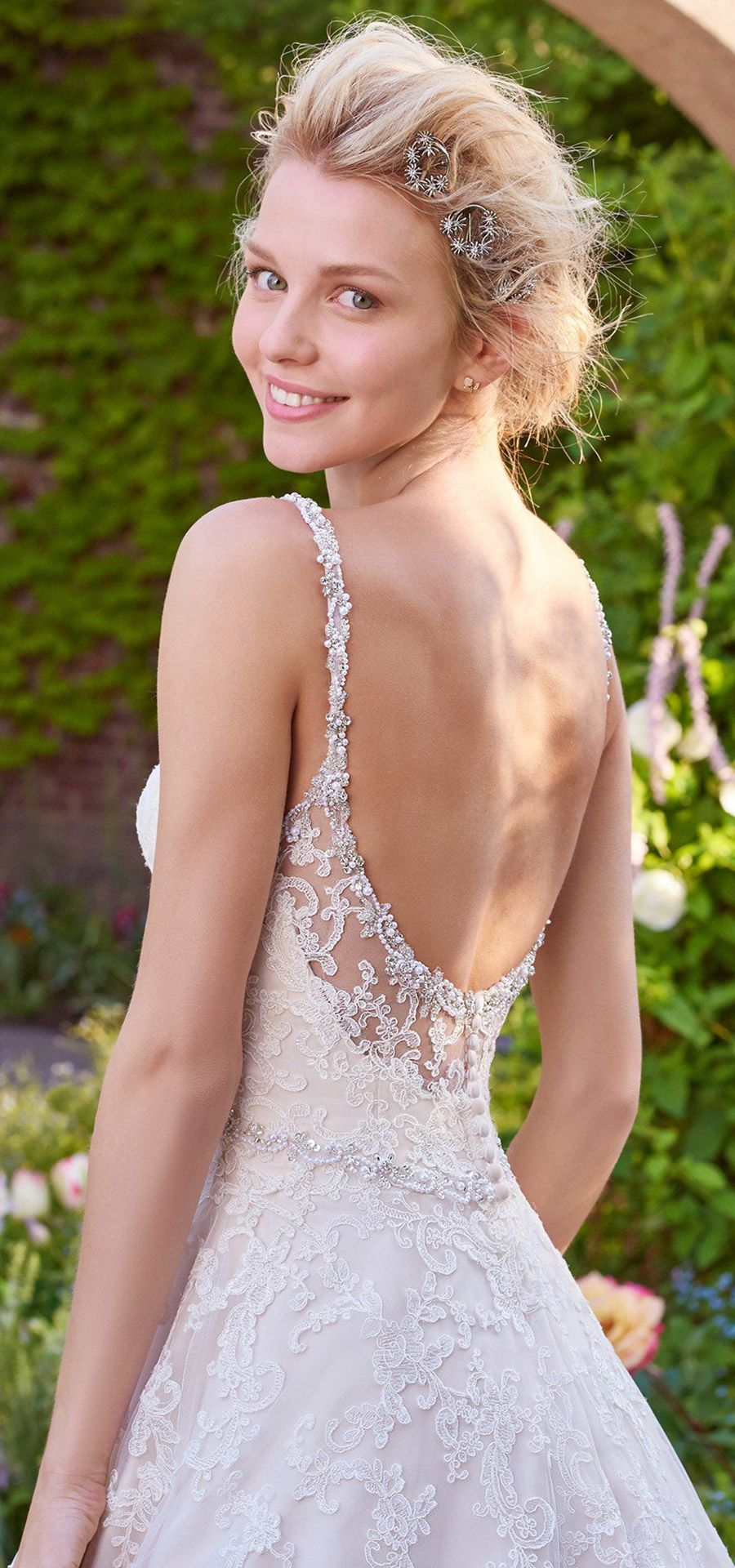 """Alluring illusion back detail on our #GownoftheWeek, #RebeccaIngram """"Allison"""". We're in love! \\\♥/// #dressoftheweek #gownoftheweek #bridal #wedding #weddingdress #weddinggown #bridalgown #dreamgown #dreamdress #engaged #inspiration #bridalinspiration #bride #weddinginspiration #weddingdresses #romantic #lace #maggiesottero"""