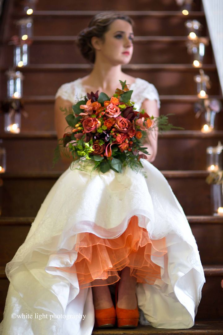 Pretty orange and cranberry colours in this autumn wedding bouquet