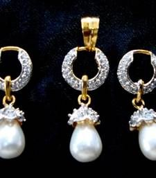 Buy AD STONE STUDDED LOCKET SET WITH WHITE PEARLS DROP  Pendant online