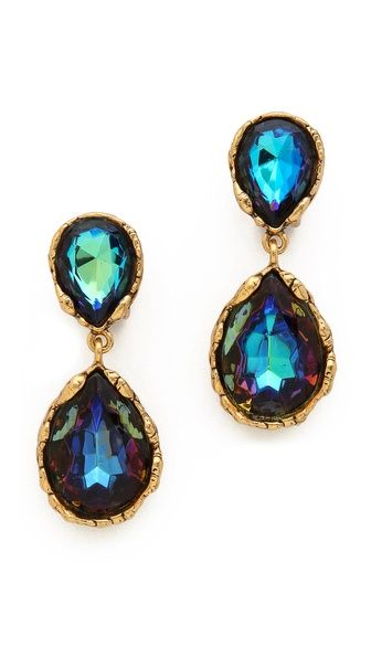 Glamorous Oscar de la Renta earrings styled with iridescent Swarovski crystals in an ornate setting.