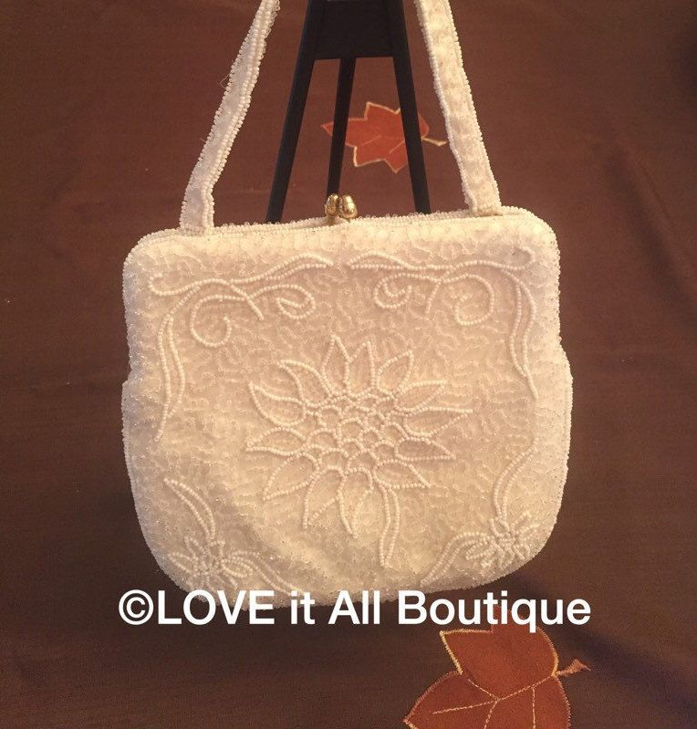 A personal favorite from my Etsy shop https://www.etsy.com/listing/258164451/vintage-white-wedding-clutch-beaded