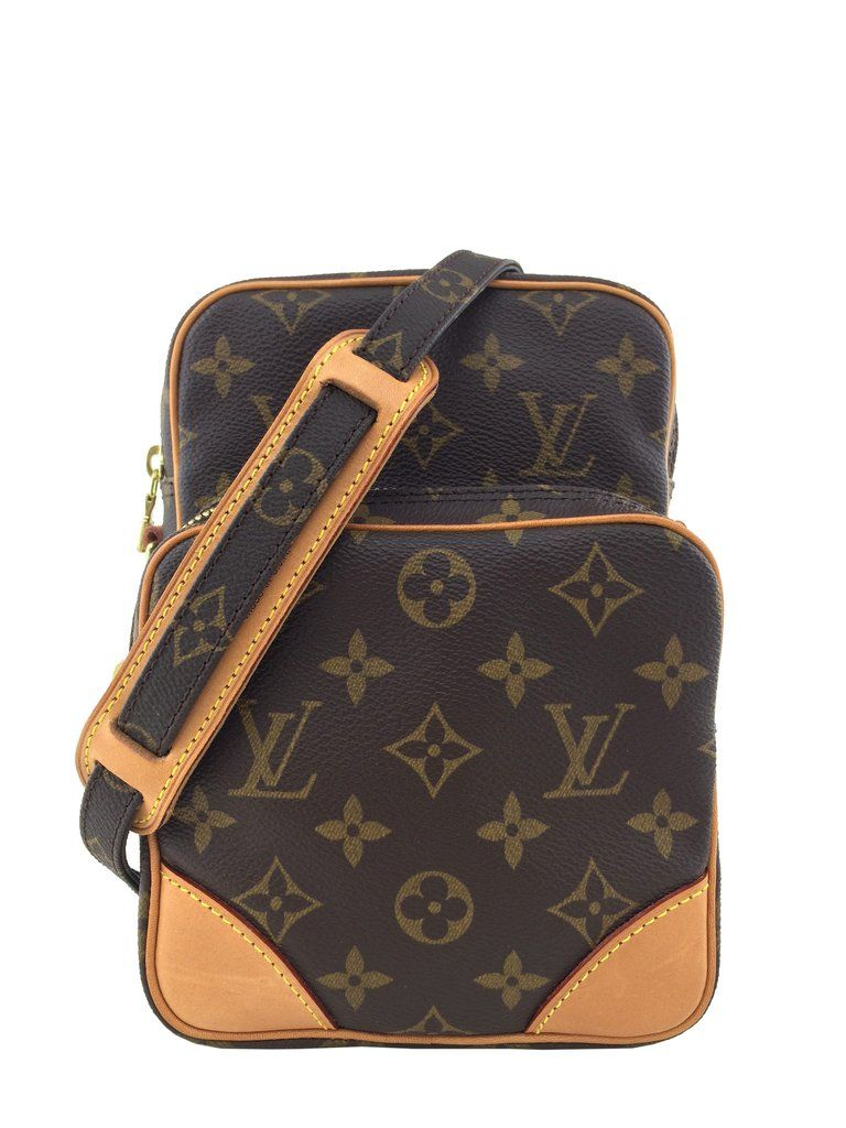 0c6f3cd69 Louis Vuitton Brown Monogram Canvas Amazone Camera Case Bag featuring an  external front zip pocket, natural leather trimmings and a flat adjustable  monogram ...