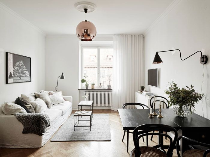 Combination Living And Dining Space With Tom Dixon Copper Pendant