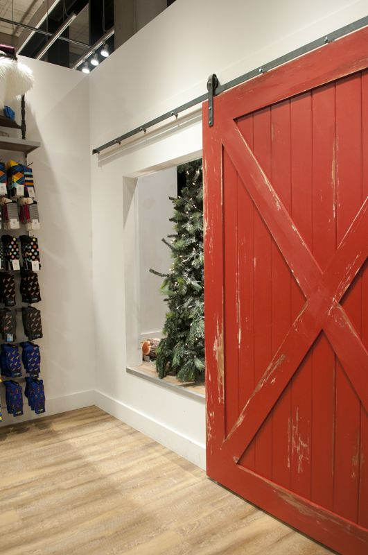 This Distressed Red Barn Door On The Heavy Metal Hardware Covers Up The  Access Opening Of