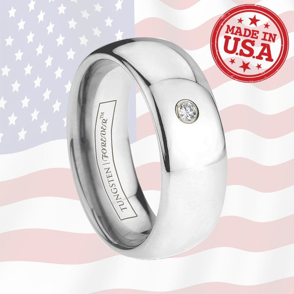 AQUARIUS 6MM / 8MM   This ring is a perfect token of enduring love. Its classic round shape is perfectly set off by a single 0.06 ctw solitaire set in a palladium bezel. This Tungsten | Forever ring is manufactured with precision for a classic work of art. Made in America.