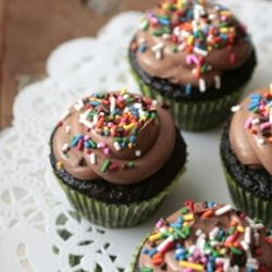 Moist, dark chocolate cupcakes with frosting that can only be described as a Nutella Cloud. #foodgawker