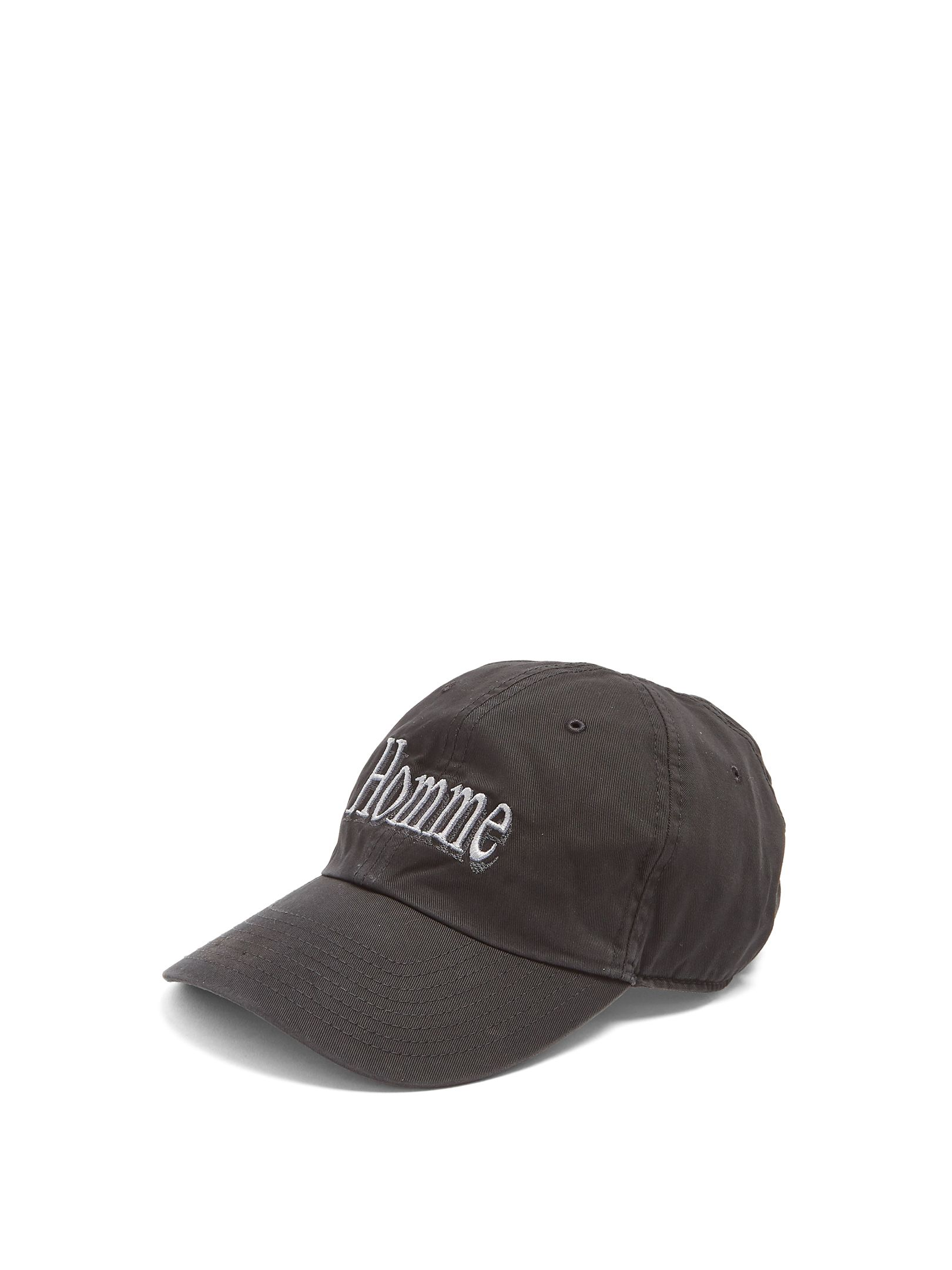 07c8ae0d624 Balenciaga s Homme-embroidered cap is a tongue-in-cheek riff on 90s  normcore styles.