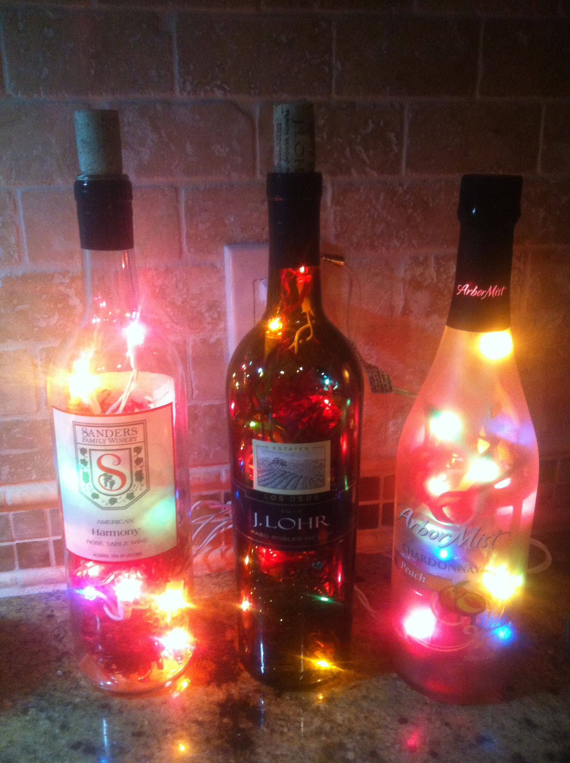 Empty Wine Bottles Christmas Lights And Confetti