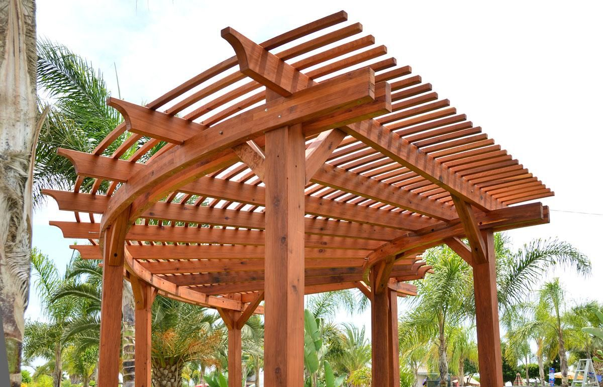 "Custom Fan Pergola (Options: External Circumference of 31' 1 1/4"", Mature Redwood, 2 3/8"" x 7 1/4"", 8"" x 8"" x 9' Posts, Transparent Premium Sealant)."