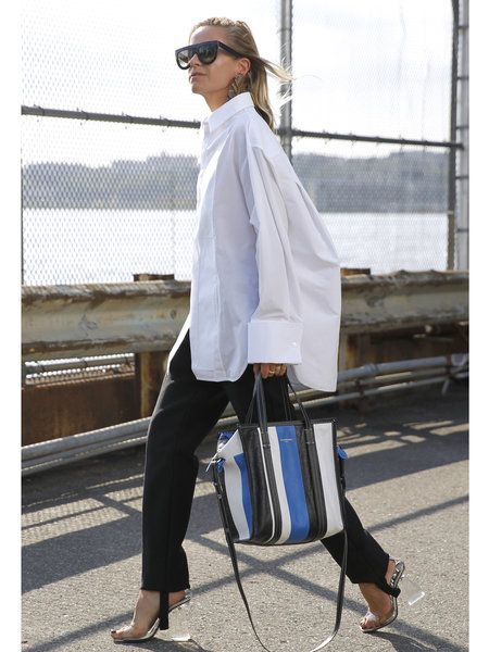 Oversized button shirt with black pants. Great airport look and perfect for fall weather