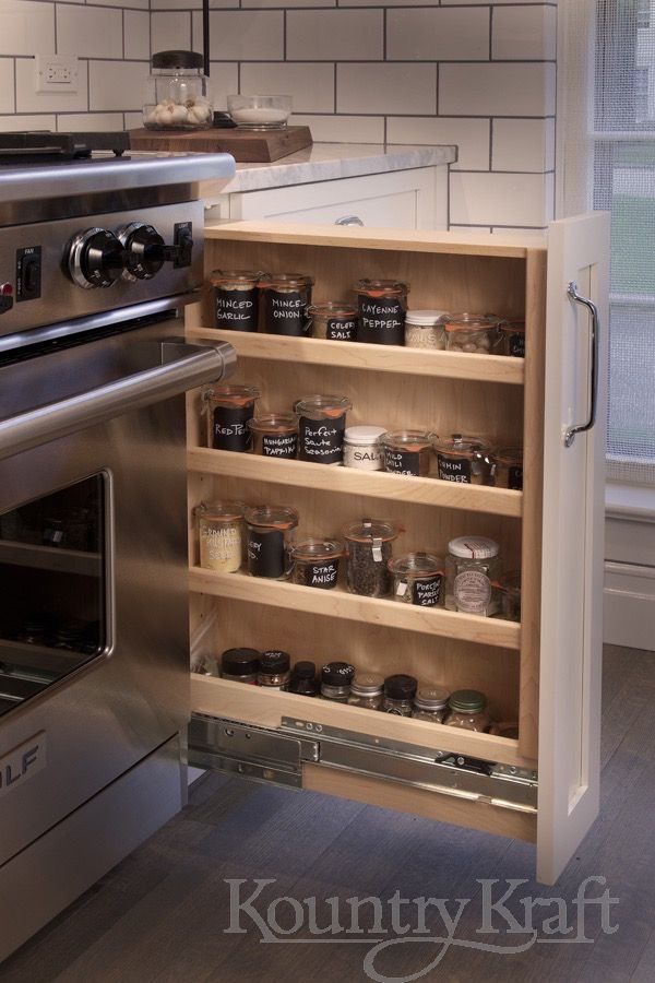 Get Organized With A Spice Rack Pull Out Easy Store Your Spices Right By Your Stove In A Spice Rack Pu Small Kitchen Storage Custom Kitchens Custom Cabinetry
