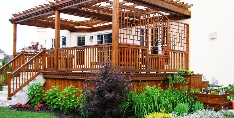 Aménagement paysager complet façade et arrière-cour gazebo en bois
