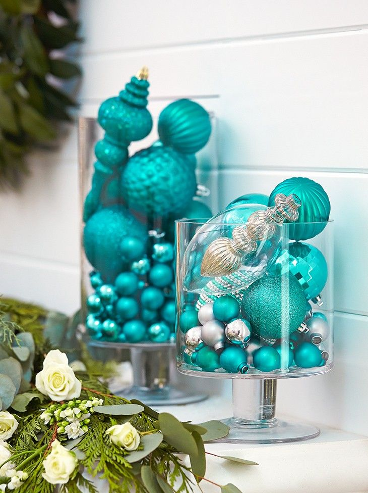 Multi-purpose your ornaments! Monika Hibbs piles frosty teal ornaments into glass vases for a gorgeous look. MyCANVAS