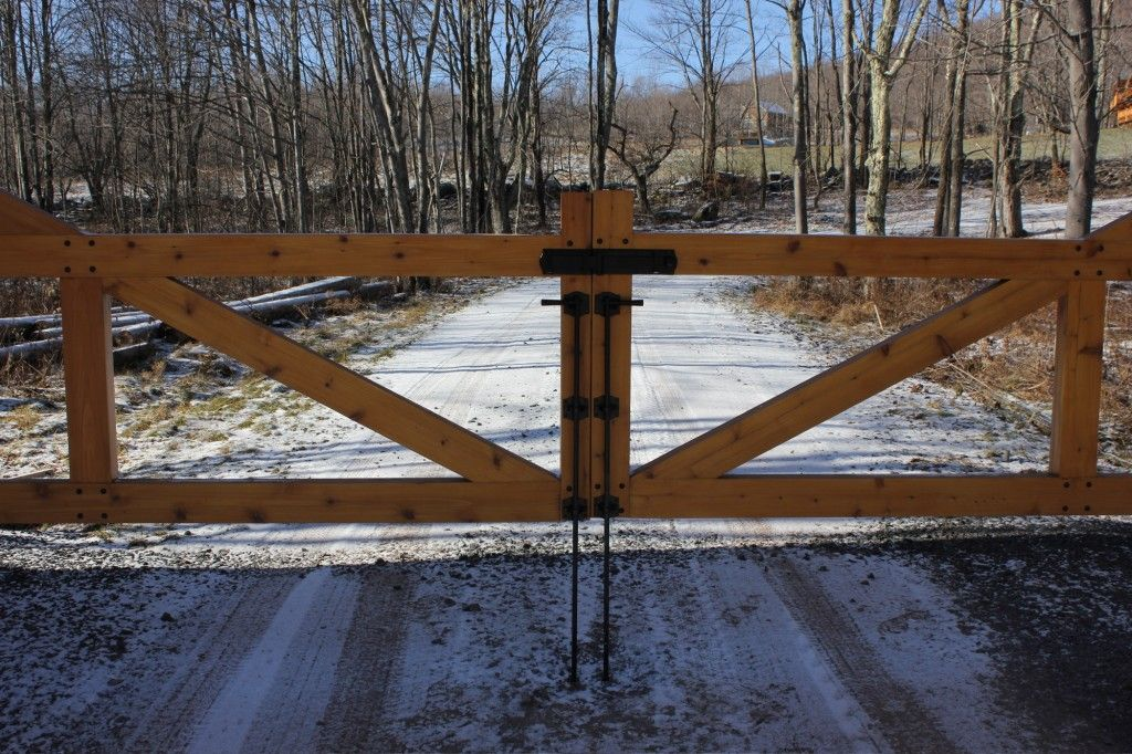 Rustic driveway gate driveway gate custom hardware for Driveway gate lock