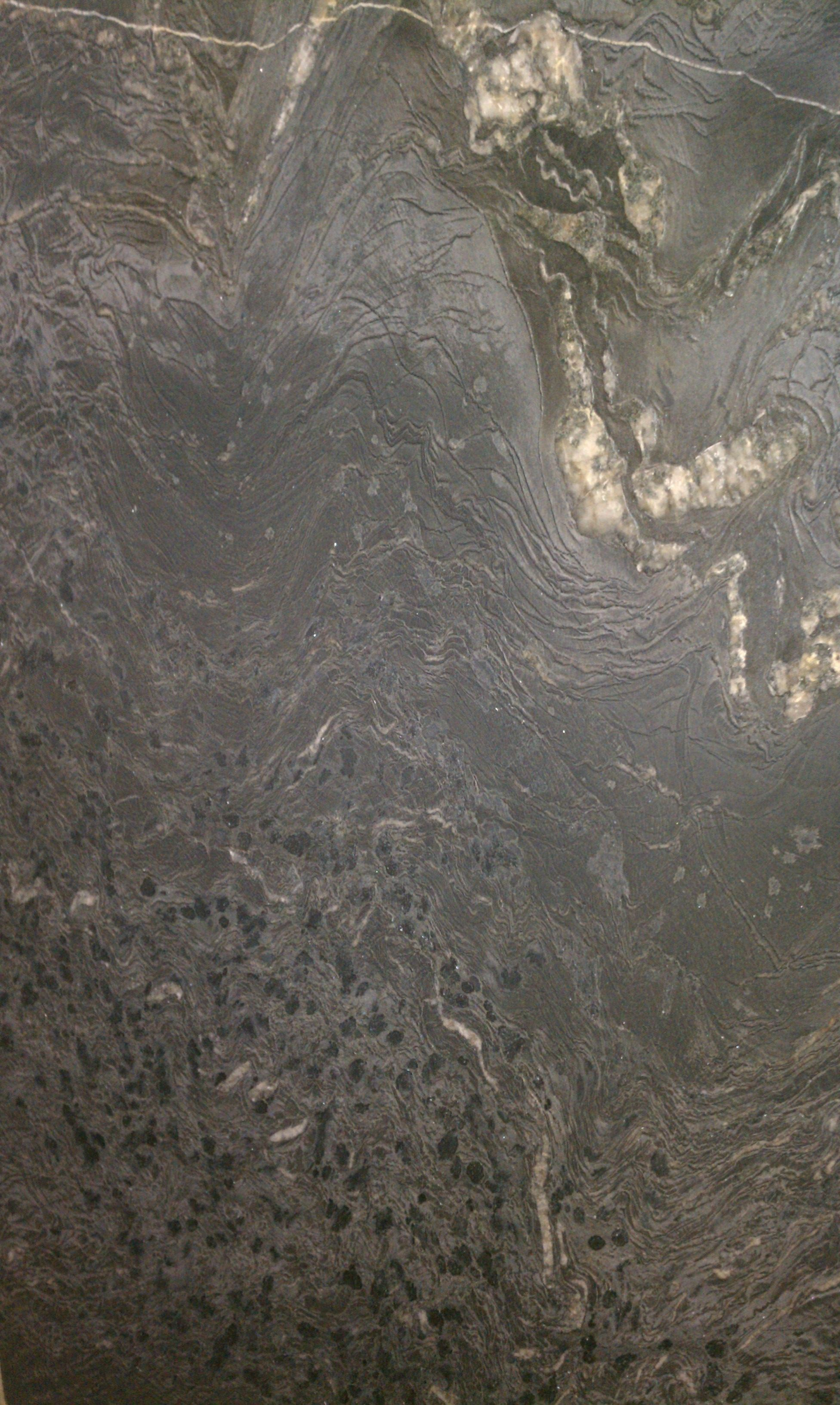 Soapstone Looking Granite : Titanium leather granite for counters great rustic