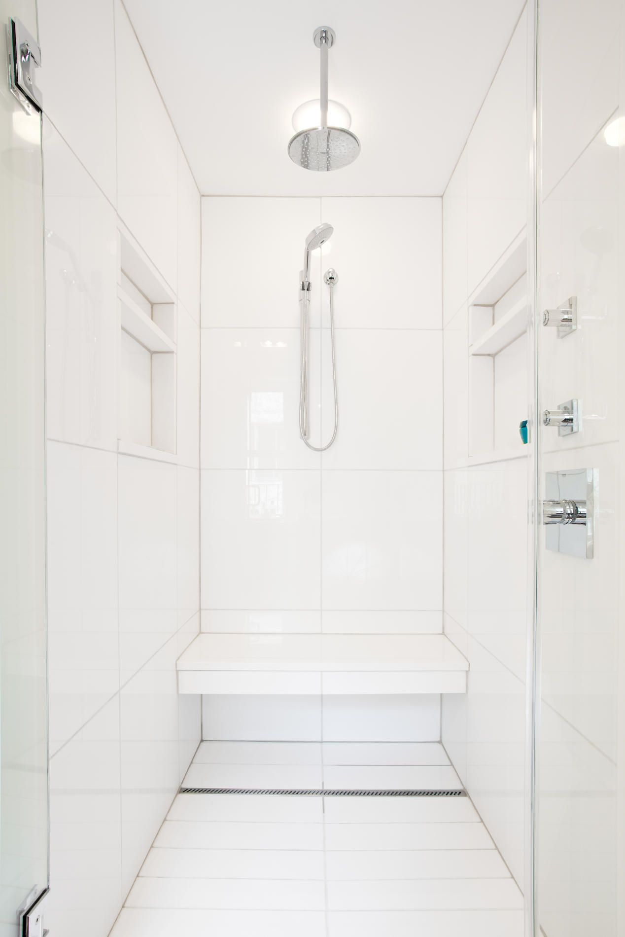 shower with bench, simple white tiles, clean lines | tiny bathroom ...