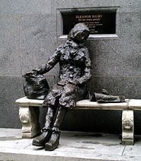 "Eleanor Rigby - A statue of Eleanor Rigby in Liverpool ,a plaque behind her describes it as ""Dedicated to all the lonely people... the beatles."