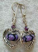 Earrings with purple heart beads