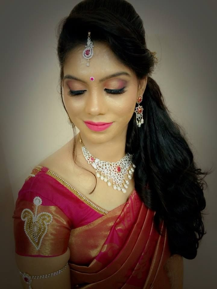 Indian bride s bridal reception  hairstyle  by Swank Studio