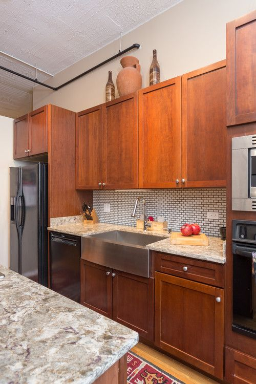 This Transitional Farmhouse Kitchen Showcases Outstanding Features, Such As  Rich Wood Shaker Cabinets, Man Made Stone Countertops, And An Ann Sacks  Savory ...