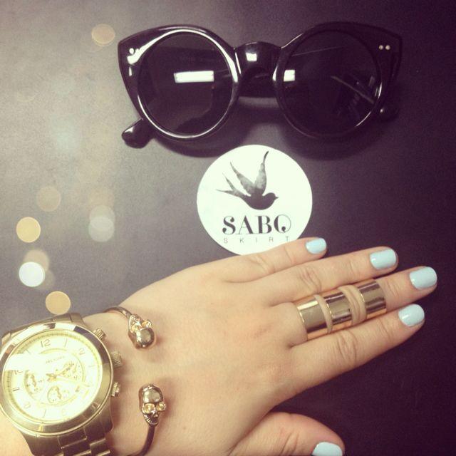 Sabo Skirt triple cuff rings & sunglasses