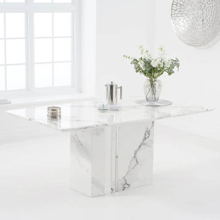 This Stylish Rectangular White Marble Dining Table Has A Feature Chunky Pedestal With Mirrored Features Dining Table Marble Marble Tables Design Dining Table