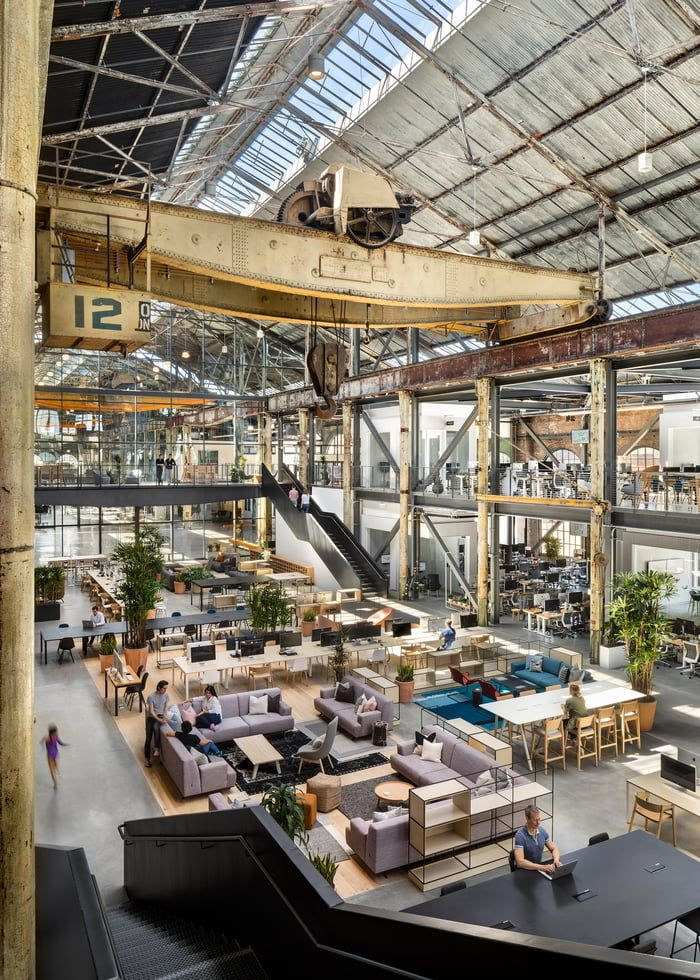 Huge historic warehouse used as a machine shop for naval vessels converted into a software company headquarters in Pier 70, San Francisco