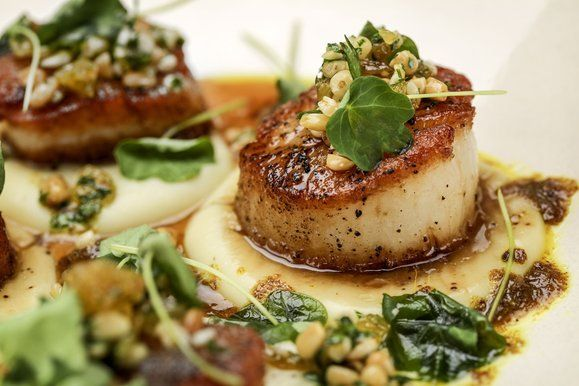 Rustic Canyon: Seared scallops, served with white yam puree, nasturtium, vadouvan and pine nut-raisin relish. (Ricardo DeAratanha / Los Ange...