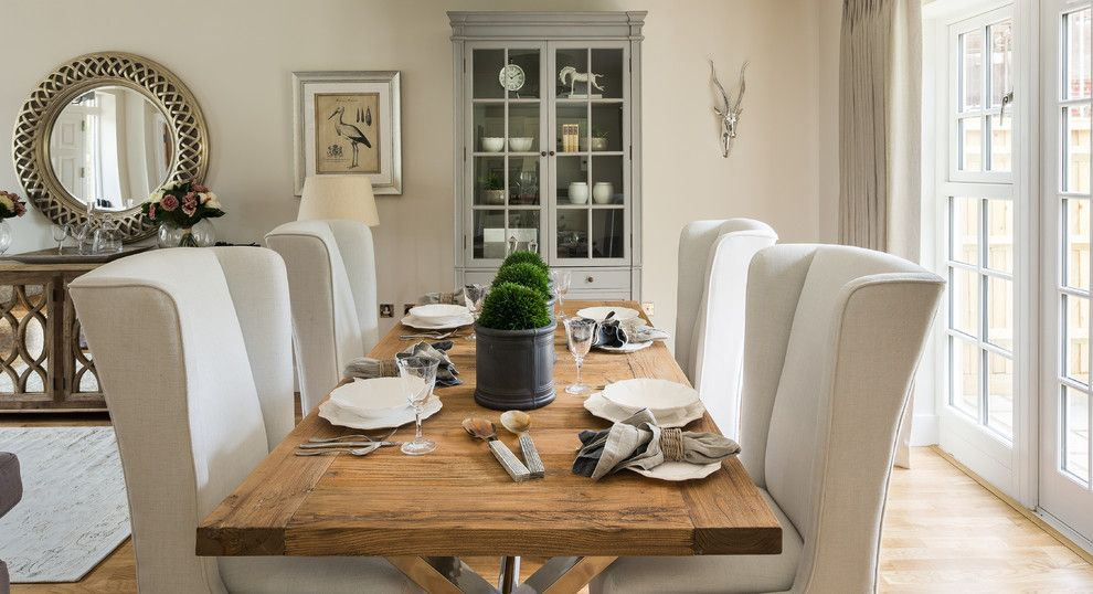 Photo Of A Country Dining Room In South East With Beige Walls And Light  Hardwood Floors