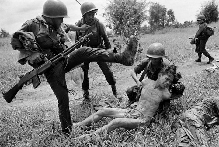 A South Vietnamese soldier kicks a Viet Cong suspect. (Photo: Rick Merron/AP - October 1965)
