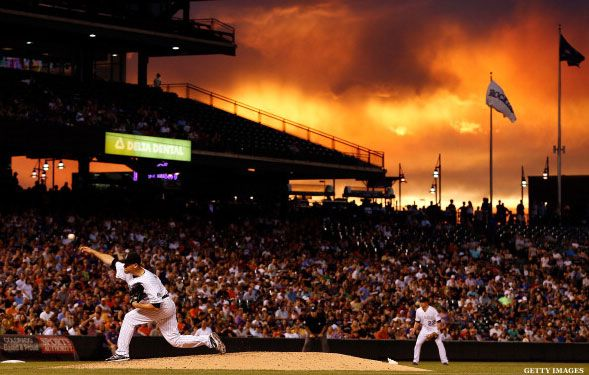 The Rockies and Giants play at dusk in Denver.