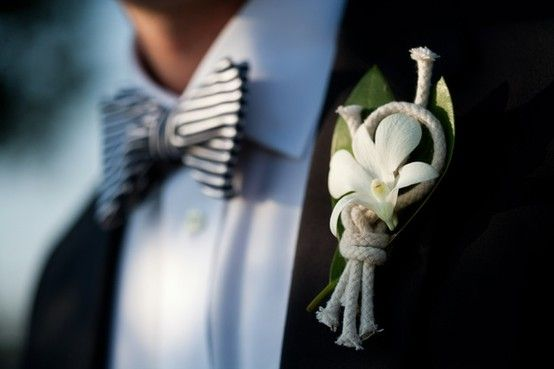 Nautical boutonniere complete with sailor's knot and white orchid. We'll have to double check if orchid's are easy to get without too much of a cost.  Otherwise, other white flowers will do too!