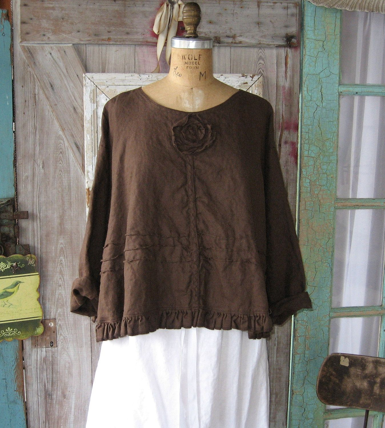 linen top flare with ruffle, tucking and a rose in bittersweet chocolate brown. Etsy.