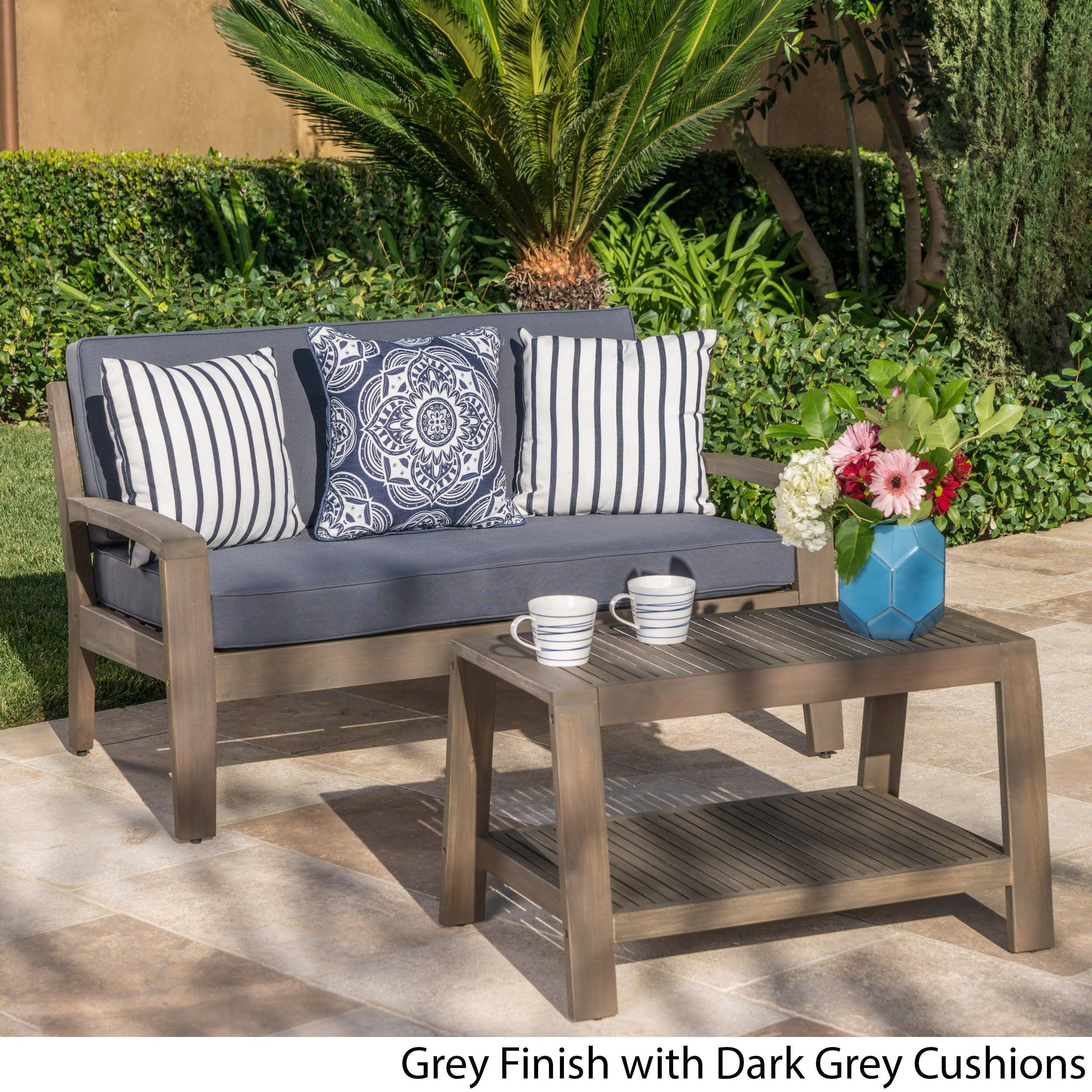 Grenada outdoor 2 piece acacia wood loveseat and coffee brown table set with cushions by christopher knight home grey finish dark grey cushions