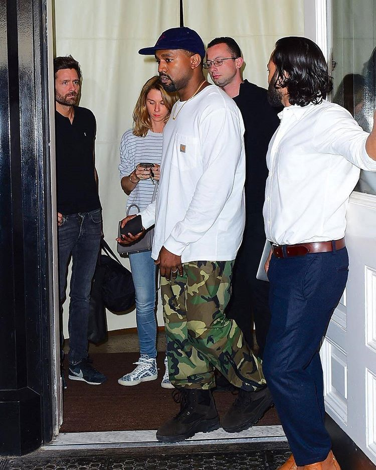 Kanye Rocking A Brain Dead Hat A Carhartt Workwear Long Sleeve A Camouflage Pants And Yeezy Season 3 Boots What Kanye Fashion Kanye West Style Kanye West